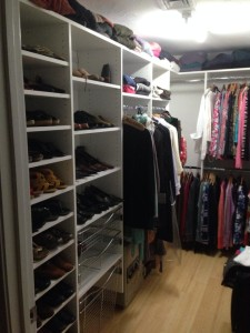 walkin closet with shoe shelves and metal basket drawers